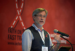 """John Blevins, an associate research professor at Emory University, speaks to the July 21 opening session of """"Faith Building Bridges"""" in Amsterdam, the Netherlands. The July 21-22 interfaith event, sponsored by the World Council of Churches-Ecumenical Advocacy Alliance, was held on the eve of the 2018 International AIDS Conference."""