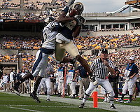 Pitt wide receiver Jonathan Baldwin (82) was unable to stay in bounds for a touchdown catch as he was forced out by FIU defensive back  Jose Cheeseborough (27). The Pittsburgh Panthers defeated Florida International Golden Panthers 44-17 at Heinz Field, Pittsburgh Pennsylvania on October 2, 2010.