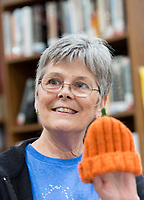 NWA Democrat-Gazette/CHARLIE KAIJO Joan Abrams of Bella Vista shows off an autumn themed cap she stitched at the Bella Vista Public Library in Bella Vista, AR on Monday, September 11, 2017. The good humored group B'Creative Stitchers meets at the library every Monday. They started two years ago. It's a group for friends to meet, check on face book and gossip, Connie Rogers of Bella Vista joked.