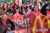 McDonalds workers, on strike over low pay in  six South London branches, protest outside the chain's WandsworthTown branch.