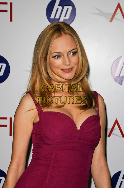 HEATHER GRAHAM .At the 10th Annual AFI Awards at the Four Seasons Hotel in Los Angeles, California, USA, January 15th, 2010..arrivals half length dress sleeveless pink cleavage purple magenta  .CAP/ROT.©Lee Roth/Capital Pictures.