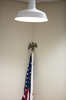 An American flag stands in a corner as Ayanna Pressley speaks at an event put on by Chelsea Black Community at the Chelsea Senior Center in Chelsea, Massachusetts, USA, on Wed., June 27, 2018. Pressley is running in the Democratic primary Massachusetts 7th Congressional District against incumbent Mike Capuano. Pressley is currently serving as a member of the Boston City Council, and is the first woman of color elected to the Council.