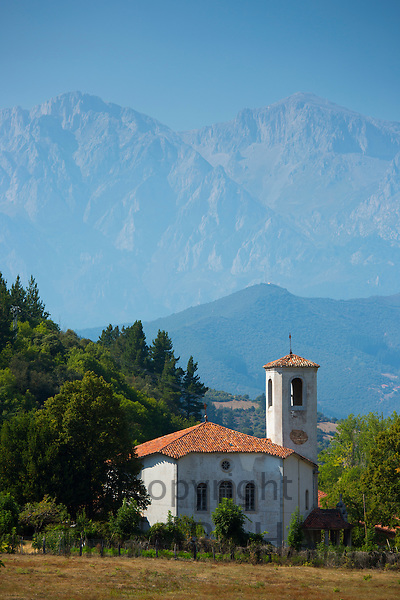 Valley church at Cabezon de Liebana in shelter of the Picos de Europa mountains in Cantabria, Northern Spain