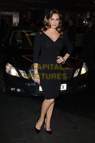 Kelly Brook.The British Fashion Awards 2012, Savoy Hotel, The Strand, London, England..November 27th, 2012.full length black dress hand on hip cleavage .CAP/CJ.©Chris Joseph/Capital Pictures.