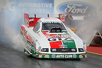 Jan 23, 2009; Chandler, AZ, USA; NHRA funny car driver John Force does a burnout during testing at the National Time Trials at Firebird International Raceway. Mandatory Credit: Mark J. Rebilas-