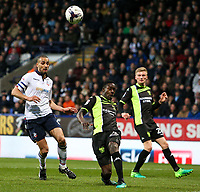 Bury's Leon Barnett clears to safety under pressure from Bolton Wanderers' Darren Pratley<br /> <br /> Photographer Alex Dodd/CameraSport<br /> <br /> The EFL Sky Bet League One - Bolton Wanderers v Bury - Tuesday 18th April 2017 - Macron Stadium - Bolton<br /> <br /> World Copyright &copy; 2017 CameraSport. All rights reserved. 43 Linden Ave. Countesthorpe. Leicester. England. LE8 5PG - Tel: +44 (0) 116 277 4147 - admin@camerasport.com - www.camerasport.com