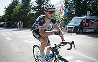 Michał Gołaś (POL/Omega Pharma-Quickstep) ditching a bottle handed by a roadside fan to cool him down up the final climb to Chamrousse (1730m/18.2km/7.3%) in +35°C<br /> <br /> 2014 Tour de France<br /> stage 13: Saint-Etiènne - Chamrousse (197km)