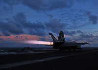 "080906-N-7981E-530 Indian Ocean (September 6, 2008)- An F/A-18E Super Hornet assigned to ""Kestrels"" of Strike Fighter Squadron (VFA) 137 launches at sunset from the flight deck of USS Abraham Lincoln (CVN 72). The Lincoln Strike Group is on a scheduled deployment in the U.S. 7th Fleet area of responsibility. Operating in the Western Pacific and Indian Ocean, the U.S. 7th fleet is the largest of the forward-deployed U.S. fleets, covering 52 million square miles, with approximately 60-70 ships, 200-300 aircraft and 40,000 Sailors and Marines assigned at any given time. U.S. Navy photo by Mass Communication Specialist 2nd Class James R. Evans (RELEASED)"
