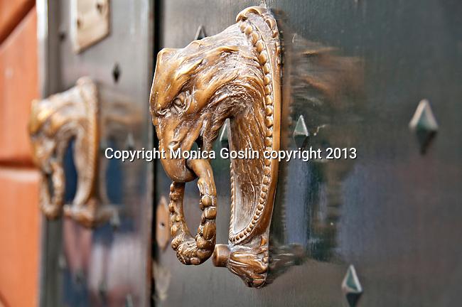 Gold door knocker of an eagle head in Genoa, Italy