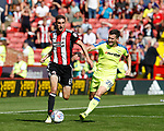 Chris Basham of Sheffield Utd tussles with David Nugent of Derby County during the Championship match at Bramall Lane, Sheffield. Picture date 26th August 2017. Picture credit should read: Simon Bellis/Sportimage