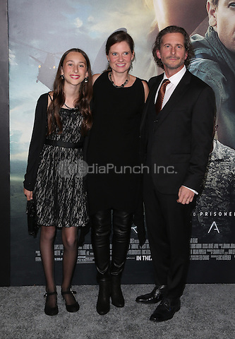 """Westwood, CA - NOVEMBER 06: Kristin Ryder,Aaron Ryder and Daughter at Premiere Of Paramount Pictures' """"Arrival"""" At Regency Village Theatre, California on November 06, 2016. Credit: Faye Sadou/MediaPunch"""