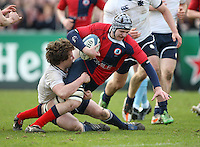 Monday 19th March - Ballyclare High School's David Allen is tackled by Methody skipper Rory Winters during the Ulster Schools Cup Final between Ballyclare High School and Methody at Ravenhill, Belfast.<br /> <br /> Picture credit: John Dickson / DICKSONDIGITAL