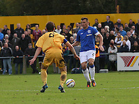 Lee McCulloch being closed down by Ross McPherson in the Forres Mechanics v Rangers William Hill Scottish Cup 2nd Round match, at Mosset Park, Forres on 29.9.12.