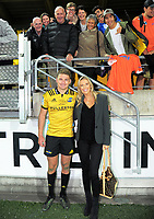 Beauden Barrett with his partner Hannah Laity and family after the Super Rugby match between the Hurricanes and Crusaders at Westpac Stadium in Wellington, New Zealand on Saturday, 10 March 2018. Photo: Dave Lintott / lintottphoto.co.nz