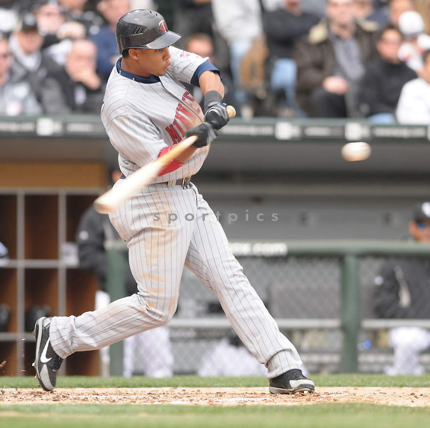 CARLOS GOMEZ, of the  Minnesota Twins in action  during the Twins game against the Chicago White Sox .  The White Sox beat the Twins 7-4 in Chicago, Illinois on April 7, 2008...David Durochik