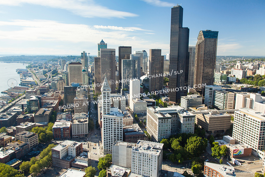 At 35 stories and 469 feet, Seattle's 100-year-old Smith Tower opened in 1914 as the tallest building west of the Mississippi River but is now dwarfed by newer downtown buildings including the sleek black, 76 story Columbia Center Tower