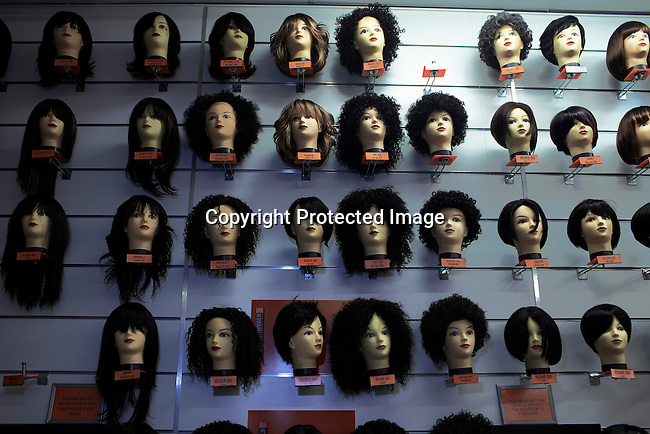 SOWETO, SOUTH AFRICA OCTOBER 5: Hair pieces are on display in a shop on October 5, 2012 at Maponya shopping Mall, Soweto, South Africa.  Maponya is one of several new shopping malls in the township. Soweto today is a mix of old housing and newly constructed townhouses. The population in Soweto is estimated to be around one million people. A new hungry black middle-class is growing steadily. Many residents work in Johannesburg but the last years many shopping malls have been built, and people are starting to spend their money in Soweto. (Photo by: Per-Anders Pettersson)