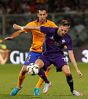 Calcio: amichevole Fiorentina vs Barcellona. Firenze, stadio Artemio Franchi, 2 agosto 2015.<br /> Fiorentina's Josip Ilicic, right, is challenged by FC Barcelona's Sergio Busquets during the friendly match between Fiorentina and FC Barcelona at Florence's Artemio Franchi stadium, 2 August 2015.<br /> UPDATE IMAGES PRESS/Riccardo De Luca