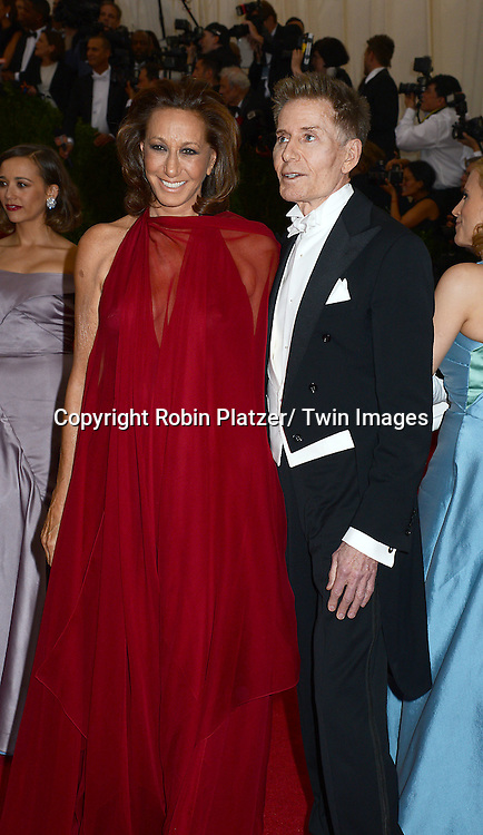 Donna Karan and Calvin Klein attends the Costume Institute Benefit on May 5, 2014 at the Metropolitan Museum of Art in New York City, NY, USA. The gala celebrated the opening of Charles James: Beyond Fashion and the new Anna Wintour Costume Center.