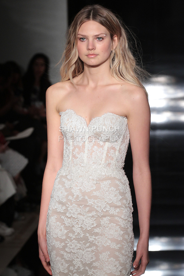 Model walks runway in a strapless re-embroidered lace corset gown, from the Reem Acra Spring 2017 bridal collection, during New York Bridal Fashion Week Spring Summer 2017, on April 15, 2016.