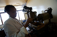 an ethiopian specialist prepares  coffee that will be tested at the main  coffee processing center in Addis Ababa, Ethiopia on Thursday January 25 2007.
