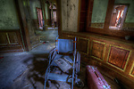 Old wheelchair in abandoned building