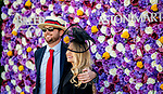 November 3, 2018 : A couple poses for a photo in front of the Aston Martin photo wall on Breeders Cup World Championships Saturday at Churchill Downs on November 3, 2018 in Louisville, Kentucky. Scott Serio/Eclipse Sportswire/CSM