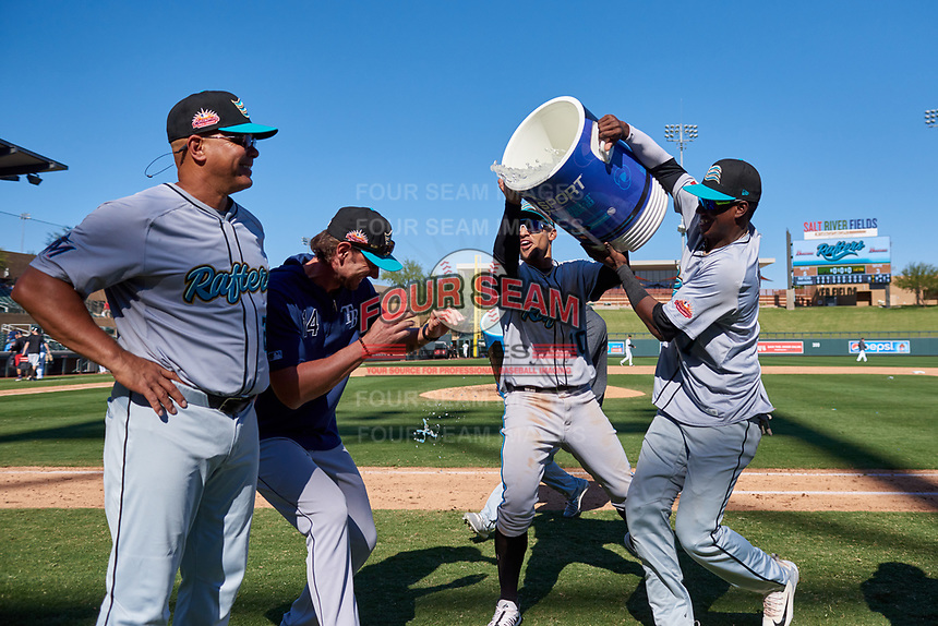 Salt River Rafters teammates Victor Victor Mesa (10) and Geraldo Perdomo (7) prepare to splash water on manager Keith Johnson (21) after winning the Arizona Fall League Championship Game against the Surprise Saguaros on October 26, 2019 at Salt River Fields at Talking Stick in Scottsdale, Arizona. The Rafters defeated the Saguaros 5-1. (Zachary Lucy/Four Seam Images)