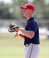Cody Adams, a local high school player, helps the GCL Nationals before a game against the GCL Mets at the Washington Nationals Minor League Complex on June 20, 2011 in Melbourne, Florida.  The Nationals defeated the Mets 5-3.  (Mike Janes/Four Seam Images)