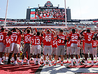 "Ohio State football players sing ""Carmen Ohio"" following a 54-21 win over the UNLV Rebels in Saturday's NCAA Division I football game at Ohio Stadium in Columbus on September 23, 2017. [Barbara J. Perenic/Dispatch]"