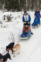 John Baker w/Iditarider on Trail 2005 Iditarod Ceremonial Start near Campbell Airstrip Alaska SC