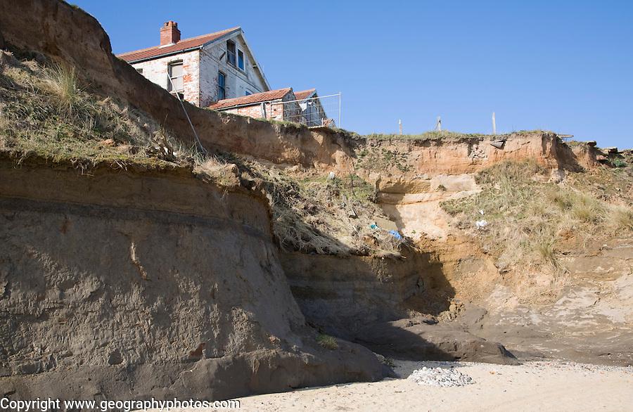 Cliff top buildings at risk of coastal erosion, Happisburgh, Norfolk, England