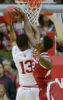 NWA Democrat-Gazette/CHARLIE KAIJO Arkansas Razorbacks forward Adrio Bailey (2) blocks Indiana Hoosiers forward Juwan Morgan (13) during the first half of the NCAA National Invitation Tournament, Saturday, March 23, 2019 at the Simon Skjodt Assembly Hall at the University of Indiana in Bloomington, Ind. The Arkansas Razorbacks fell to the Indiana Hoosiers 63-60.