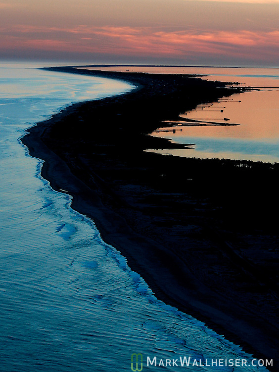 The sun sets on the Gulf of Mexico, left, and Apalachicola Bay, right at St.George Island along the Forgotten Coast in Franklin County southwest of Tallahassee, Florida.   (Mark Wallheiser/TallahasseeStock.com)
