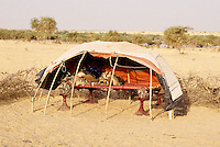 Akadaney, Central Niger, West Africa.  Fulani Nomads.  Portable Bed with Open Sleeping Enclosure.
