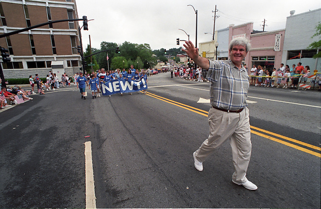 UNITED STATES FILE PHOTO: Rep. Newt Gingrich, R-Ga., waves to the crowd during the 1994 4th of July parade in Marietta, Ga. (Photo by Bill Clark)