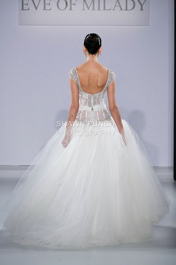 Model walks runway in bridal dress from the Eve Of Milady Fall 2013 Boutique collection, by Eve Muscio, during Couture New York Bridal Fashion Week, October 12, 2012.