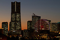 Minato Mirai buildings, including Landmark Tower, at sunset. Sakuragicho, Yokohama, Kanagawa, Japan. Friday February 3rd 2017