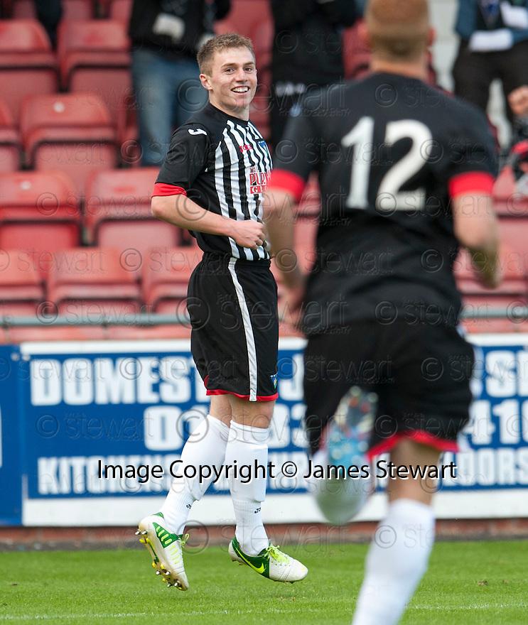 Pars' Allan Smith celebrates after he scores their third goal.