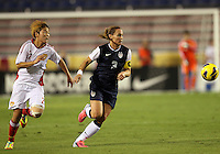 BOCA RATON, FL - DECEMBER 15, 2012: Christie Rampone (3) of the USA WNT chases a loose ball with Li Ying (27) of China WNT during an international friendly match at FAU Stadium, in Boca Raton, Florida, on Saturday, December 15, 2012. USA won 4-1.