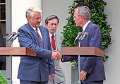 United States President George H.W. Bush, right, and President Boris Yeltsin of the Russian Federation, left, shake hands after announcing an arms control agreement that will eliminate all of Russia's most powerful SS-18 multiple warhead missiles, in the Rose Garden of the White House in Washington, D.C. on June 16, 1992.  After making their statements the presidents took questions from the media.<br /> Credit: Ron Sachs / CNP