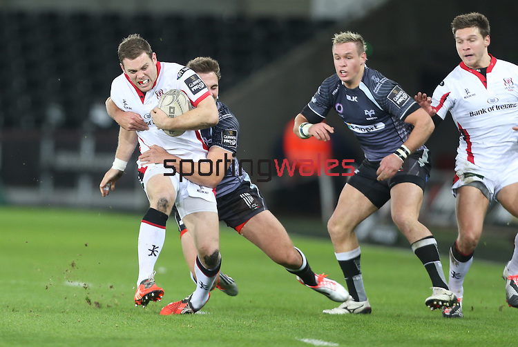 Ospreys centre Ashley Beck tackles Ulster centre Darren Cave.<br /> Guiness Pro12<br /> Ospreys v Ulster<br /> 20.12.14<br /> ©Steve Pope -SPORTINGWALES