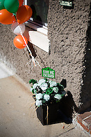 "A flower pot with a sign that says ""Kiss Me I'm Irish"" and balloons in the colors of the Irish flag stand outside a house in South Boston, Massachusetts, on the day of the St. Patrick's Day Parade."
