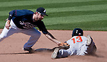 Reno Aces second baseman Tyler Bornick makes the tag on Fresno Grizzlies runner Juan Ciriaco on Sunday afternoon, August 26, 2012 in Reno, Nevada.