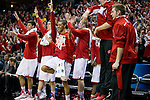 Wisconsin Badgers teammates celebrate during the third-round game in the NCAA college basketball tournament against the Oregon Ducks Saturday, April 22, 2014 in Milwaukee. The Badgers won 85-77. (Photo by David Stluka)