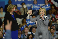 "Charlotte, NC - March 14, 2016: Former U.S. Secretary of State and 2016 Democrat presidential candidate Hillary Clinton greets Charlotte, NC, Mayor Jennifer Roberts on stage before to speaking supporters during a campaign event at the Grady Cole Center in Charlotte, North Carolina, March 14, 2016, one day before 'Super Tuesday"" voting.  (Photo by Don Baxter/Media Images International)"