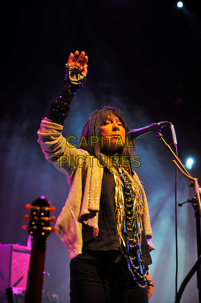 Buffy Sainte-Marie .Performing at the Meltdown Festival, Queen Elizabeth Hall, Waterloo, London, England. .7th August 2012.on stage in concert live gig performance music half length silver sequins sequined jacket hand arm in air fingerless gloves black scarf .CAP/MAR.© Martin Harris/Capital Pictures.
