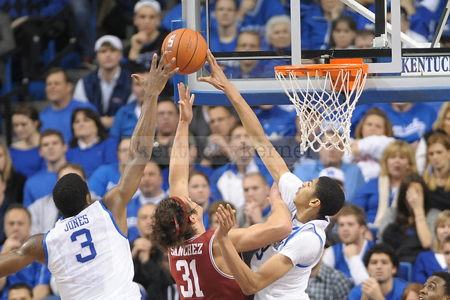 UK's Anthony Davis and Terrence Jones both block Arkansas' Michael Sanchez shot during the second half of the University of Kentucky men's basketball game against Arkansas at Rupp Arena in Lexington, Ky., on 1/17/12. UK won the game 86-63. Photo by Mike Weaver | Staff