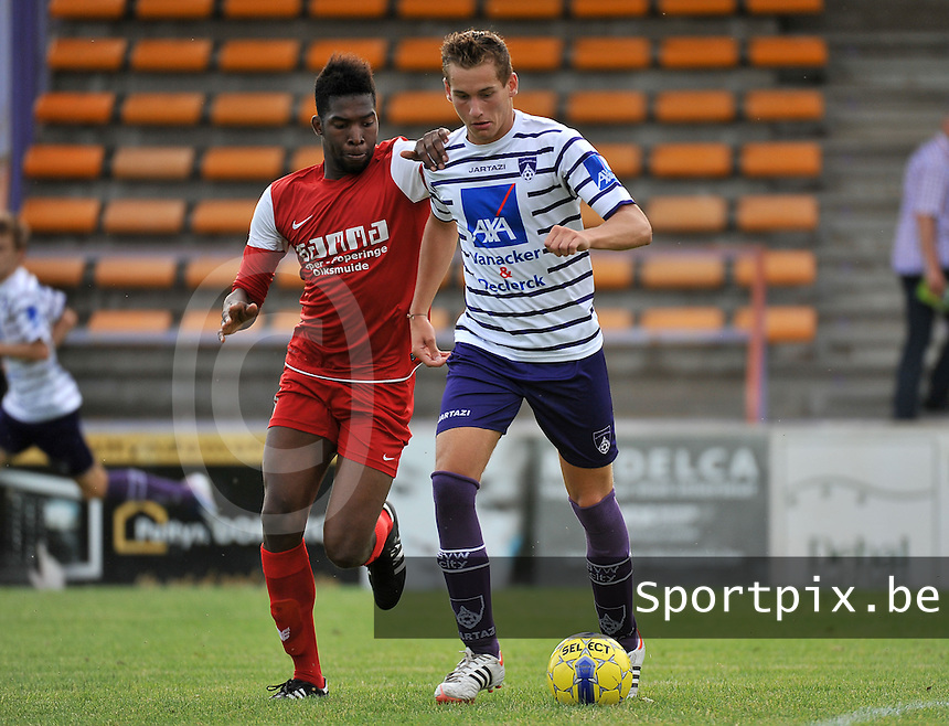 SV Wevelgem City : Jelmer Platteeuw (rechts) in duel met Jean Affognon (links) van Langemark<br /> foto VDB / Bart Vandenbroucke