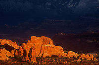 714000051 sunset ligth turns the sandstone formations in the fiery furnace a brilliant reddish gold in arches national park in utah